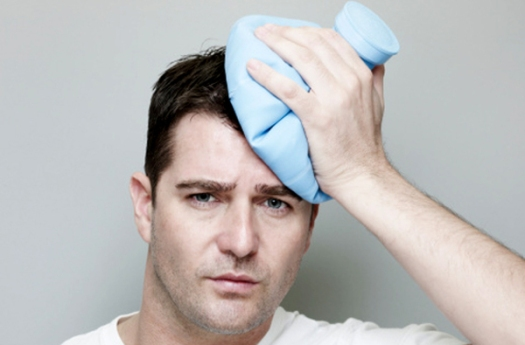 Man Holding Ice Pack On Head.